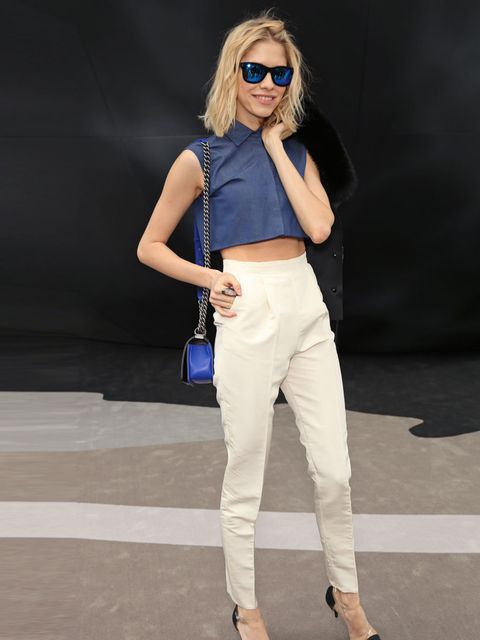 "<p>Elena Perminova arrives at the <a href=""http://cms.elleuk.com/catwalk/designer-a-z/valentino/autumn-winter-2013"">Valentino</a> Autumn/Winter 2013 wearing a blue cropped shirt and white high waisted trousers. Paris, March 2013.</p>"