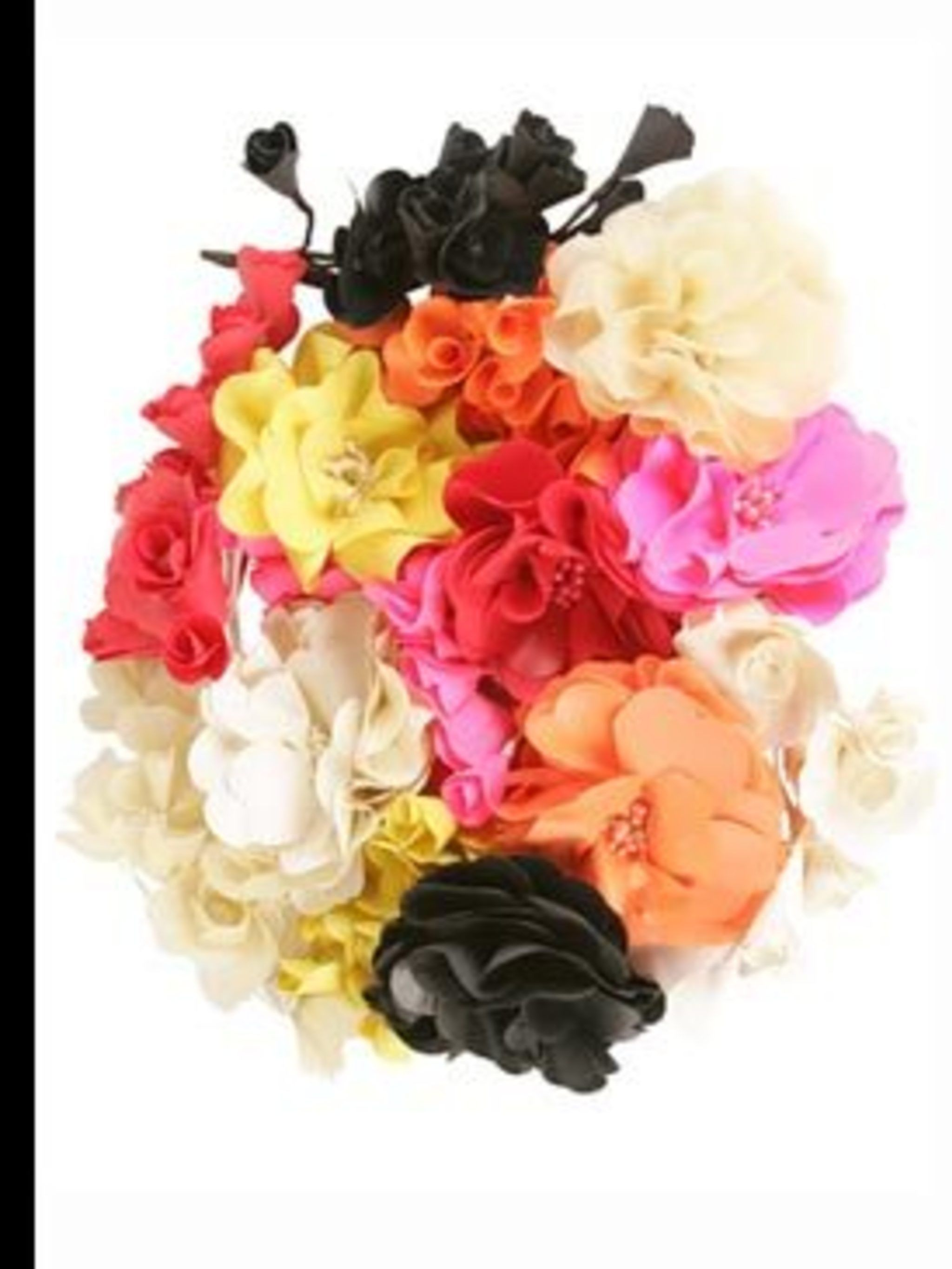 <p>Floral hair pieces, £106 each, by Sonia Rykiel. For stockist details call 020 7493 5255.</p>
