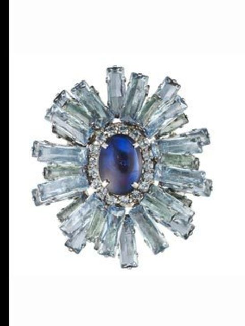 """<p>""""Eclat"""" brooch, £520, by Louis Vuitton. For stockist details call 020 7399 4050. </p>"""