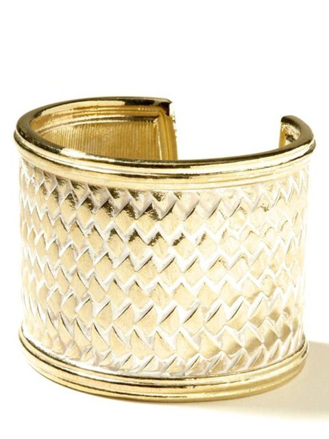 <p>Embossed gold cuff, £25, by Banana Republic (0207 758 3550)</p>