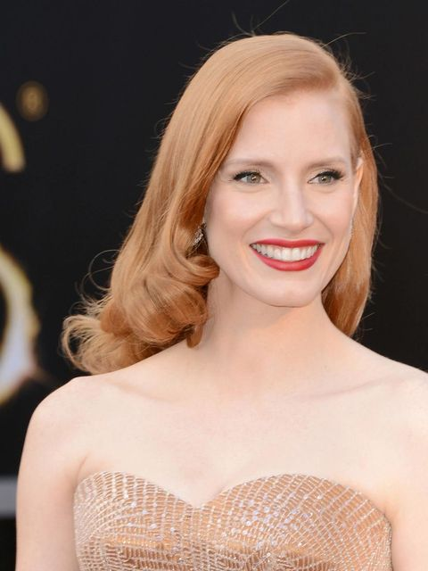 """<p>The first nominee to arrive, <a href=""""http://www.elleuk.com/star-style/celebrity-style-files/jessica-chastain"""">Jessica Chastain</a> makes the right first impression. The first rule of a red carpet red lip? Keep everything else perfectly tonal so the ma"""