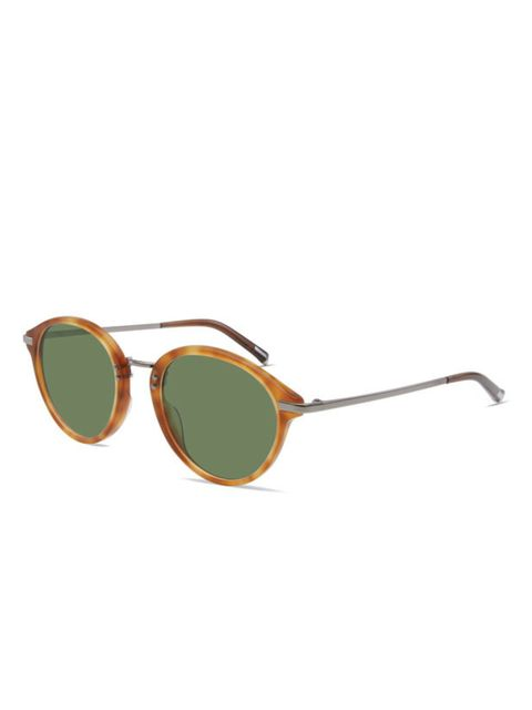 <p>Round tortoiseshell sunglasses, £225, by Calvin Klein Classic Collection (0800 722 020)</p>