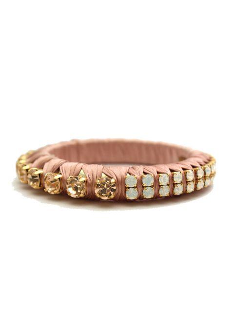 <p>Embellished ribbon bracelet, £135, by Paula Bianco at Cochinechine (0207 435 9377)</p>