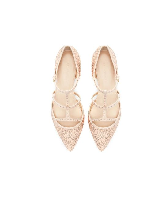 "<p>Flat shoes needn't be boring - follow in Fashion Assistant Espe de la Fuente's footsteps with an embellished pump.</p><p><a href=""http://www.zara.com/uk/en/woman/shoes/shiny-pointy-ballerina-c269191p1296407.html"">Zara</a> shoes, £59.99</p>"