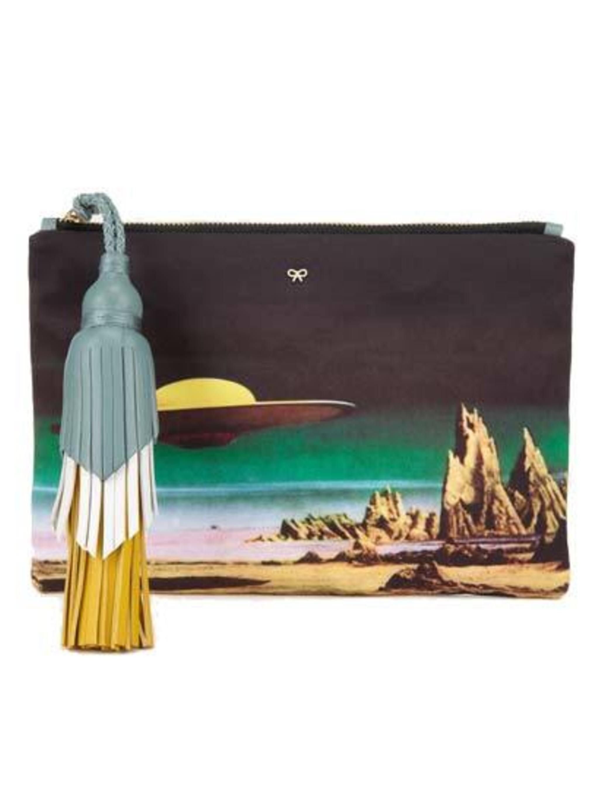 "<p>Is it a clutch, pouch, bag or all of the above.   All we know is we can't enough of them . . </p><p>Mars attacks .. </p><p>Ufo print clutch £395 by <a href=""http://www.anyahindmarch.com/View-All/Courtney-Planet-Cruiser-clutch/Multi-5050925821230.html?s"