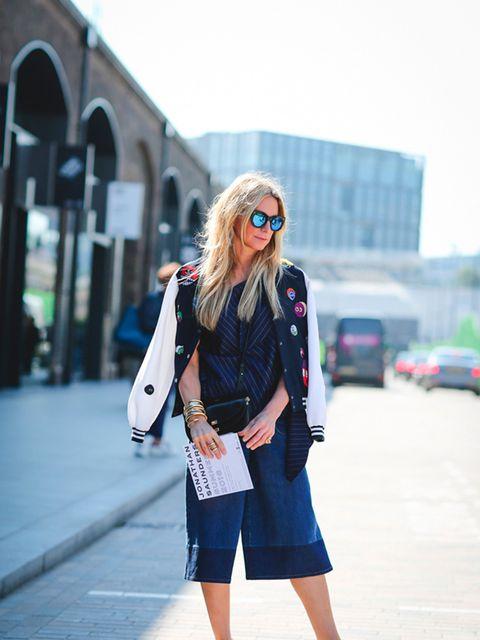 Jennifer Fisher wears Mira Mikati jacket, Valentino jeans, JW Anderson top, Celine shoes and Chloe bag
