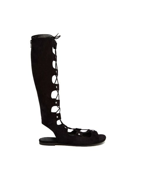 """<p><a href=""""http://www.asos.com/ASOS/ASOS-FEODORA-Knee-High-Lace-Up-Sandals/Prod/pgeproduct.aspx?iid=5220091&cid=17170&sh=0&pge=0&pgesize=36&sort=-1&clr=Black&totalstyles=219&gridsize=3"""" target=""""_blank"""">ASOS</a> gladiator sandals, £45</p>"""