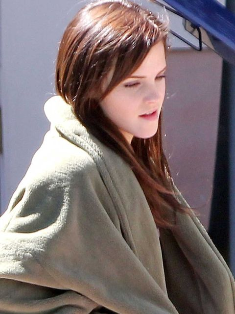 <p>Emma Watson wearing hair extensions on the set of her new film, The Bling Ring</p>
