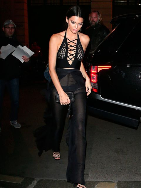 <p>Kendall Jenner wears a sheer Balmain jumpsuit whilst attending Olivier Rousterig's SS16 womenswear line launch party in Paris, September 2015.</p>