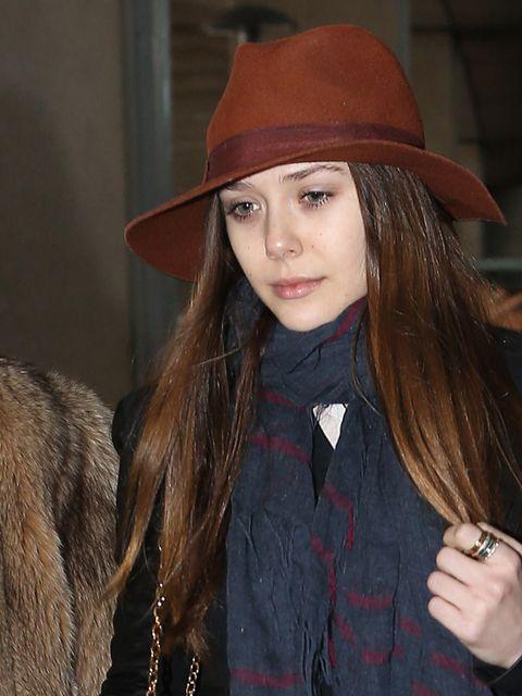 <p>Elizabeth Olsen wearing a brown fedora hat.</p>