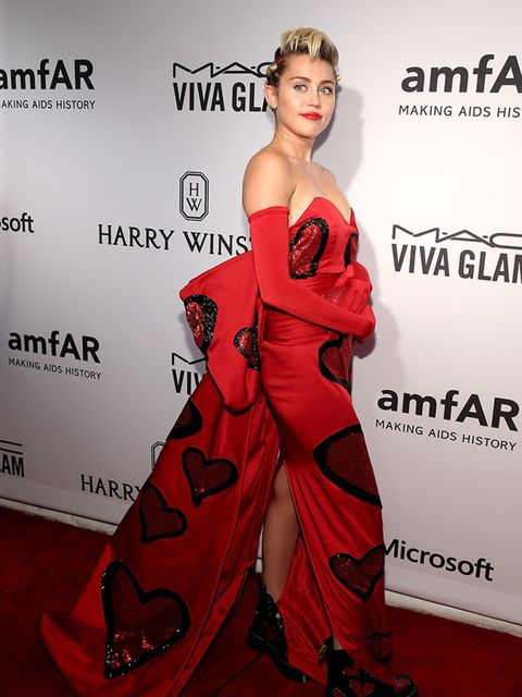 <p>Miley Cyrus wears a custom Moschino gown by Jeremy Scott with Doc Martens to the amfAR Inspiration Gala, New York, June 2015.</p>