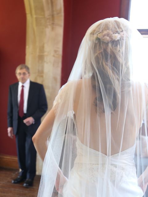 <p><strong>The Veil and Garland</strong></p><p>'We were having a church ceremony, so I thought it wise to temper the raciness of my gown's low-cut back with a demure veil. I chose a single layer, full length style, which cascaded to the floor in perfect s
