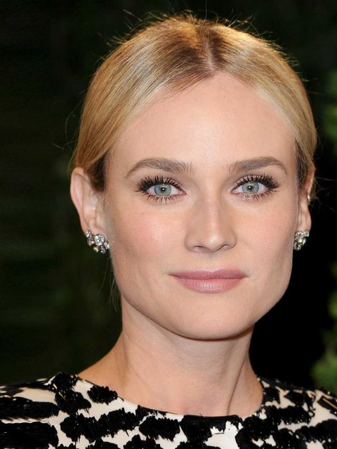 "<p>Diane Kruger nods to the <a href=""http://www.elleuk.com/beauty/hair/hair-trends/60s-styles"">sixties</a> with full, fluttery lashes and a nude lip shade. </p>"
