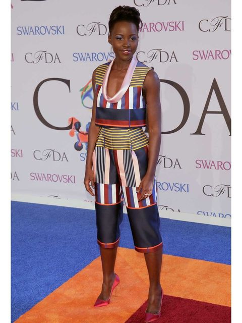 "<p><a href=""http://www.elleuk.com/star-style/celebrity-style-files/lupita-nyong-o-style-file-actress-miu-miu-chanel-couture"">Lupita Nyong'o</a> attends the 2014 CFDA Fashion Awards wearing Suno.</p>"