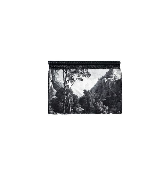 <p>Dries Van Noten monochrome printed clutch, £432, at Browns, for stockists 0207 514 0040</p>