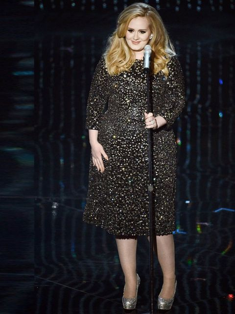 "<p>Adele wore a sparkly <a href=""http://www.elleuk.com/catwalk/designer-a-z/burberry-prorsum/autumn-winter-2013"">Burberry</a> dress for her performance at the Oscars where she won Best Original Song Oscar for Skyfall, February 2013.</p>"