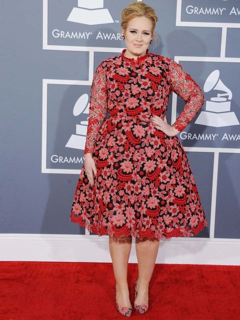 "<p>Adele wore a floral print <a href=""http://www.elleuk.com/catwalk/designer-a-z/valentino/autumn-winter-2013"">Valentino</a> dress to pick up her ninth award from the The 55th Annual Grammy Awards at Staples Center in Los Angeles, February 2013.</p>"