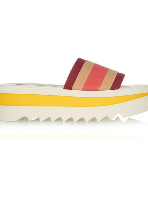 "<p>£365, <a href=""https://www.net-a-porter.com/gb/en/product/645258/Stella_McCartney/striped-faux-leather-and-canvas-platform-slides"">Stella McCartney</a></p>"