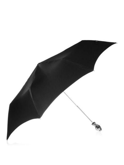 "<p>Alexander McQueen skull handle umbrella, £330, at <a href=""http://www.net-a-porter.com/product/164741"">Net-a-Porter</a></p>"