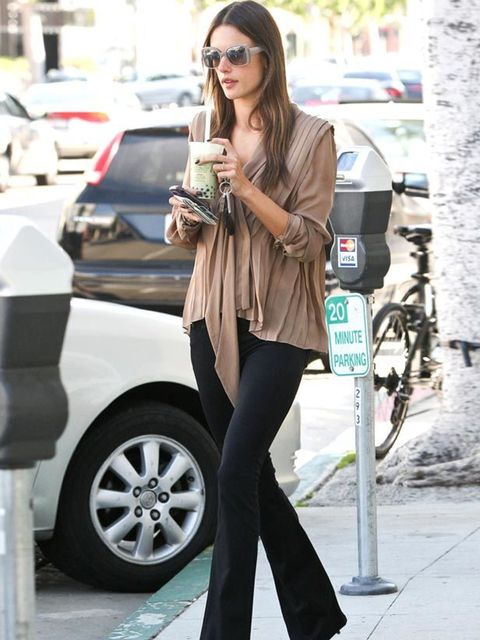 """<p><a href=""""http://www.elleuk.com/starstyle/style-files/%28section%29/alessandra-ambrosio/%28offset%29/0/%28img%29/564476"""">Alessandra Ambrosio</a> styling her 70s flared jeans with a caramel blouse</p>"""