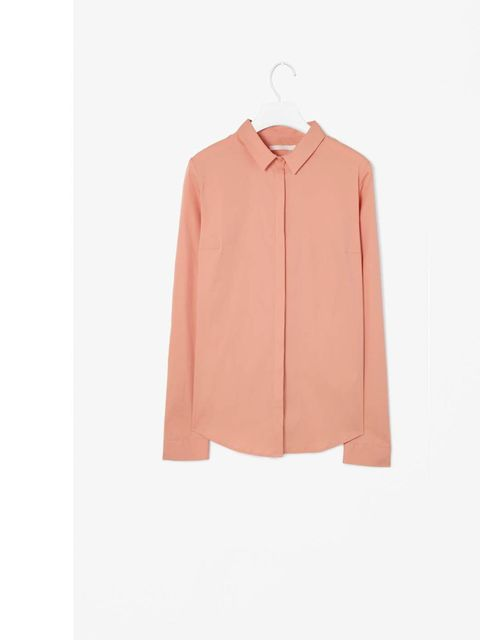 "<p>The clean lines and cut of this shirt fit well with the ongoing minimal trend but the soft apricot keeps it feminine and pretty and would work well with blue denims or smarter navy tailored pieces. Slim Fit Shirt, £45 <a href=""http://www.cosstores.com/"