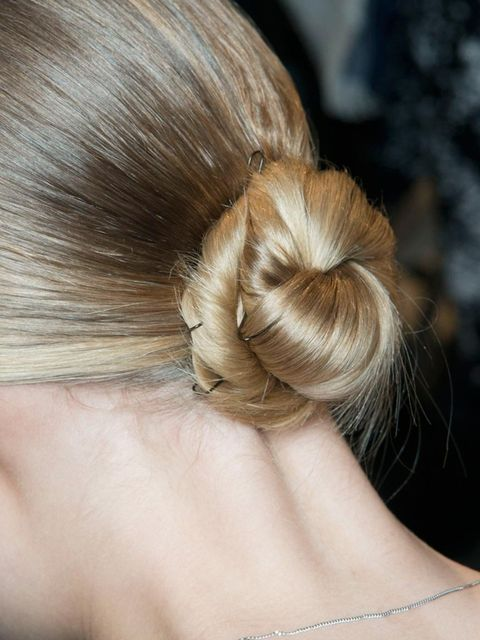 <p>We love this twisted bun at Akris. The pin detail adds extra intereet to an otherwise simple up-do.</p>