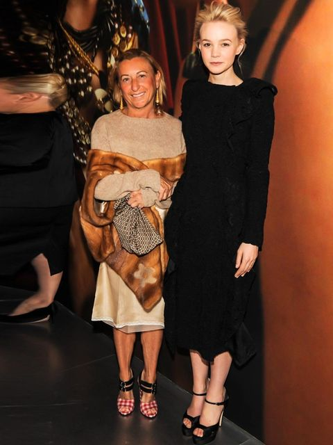 "<p><a href=""http://www.elleuk.com/star-style/celebrity-style-files/carey-mulligan"">Carey Mulligan</a> in a black Prada dress, with Miuccia Prada.</p>"