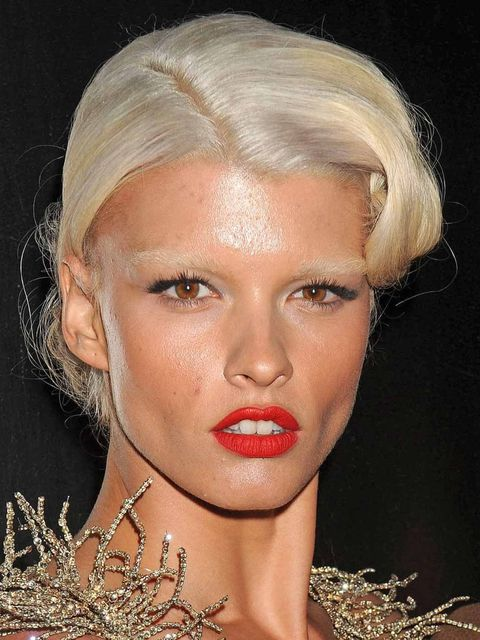 <p>Crystal Renn with platinum blonde hair and matching eyebrows</p>