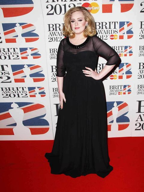 """<p><a href=""""http://www.elleuk.com/star-style/celebrity-style-files/adele"""">Adele</a> wearing <a href=""""http://www.elleuk.com/catwalk/designer-a-z/burberry-prorsum/autumn-winter-2012"""">Burberry Prorsum</a> and De Beers jewellery on the red carpet at the 2012"""