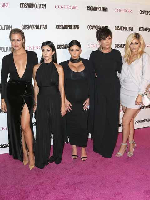Kourtney and Kim Kardashian rep Balmain at Cosmopolitan's 50th birthday party. Kourtney opts for a current collection black jumpsuit, and Kim accessorises with a chunky Balmain necklace.