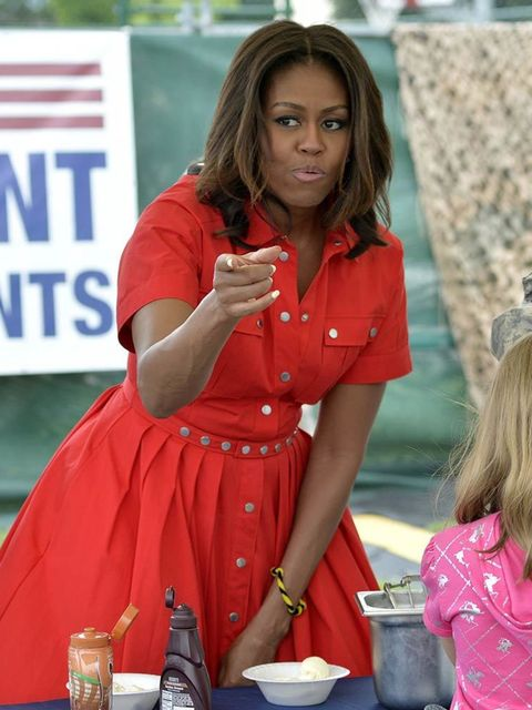Michelle Obama distributes food to people at the United States and Nato military base in Aviano, Italy, June 2015.