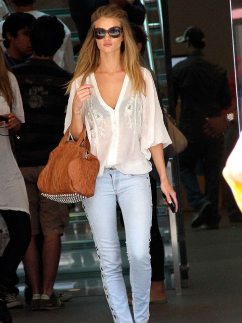 """<p><a href=""""http://www.elleuk.com/starstyle/style-files/%28section%29/rosie-huntington-whiteley/%28offset%29/0/%28img%29/364028"""">Rosie Huntington-Whiteley</a> carrying an <a href=""""http://www.elleuk.com/catwalk/collections/alexander-wang/autumn-winter-2010"""