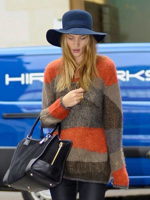 "<p><a href=""http://www.elleuk.com/starstyle/style-files/(section)/rosie-huntington-whiteley"">Rosie Huntington-Whiteley</a> mixing a Joie striped jumper with a floppy 70s hat while out in London, October 2011</p>"