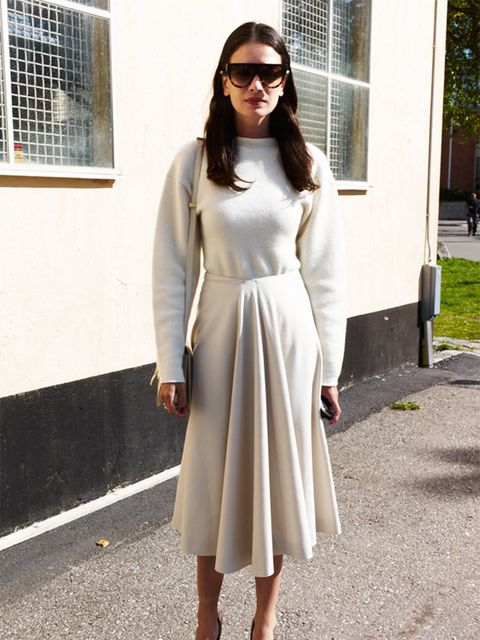 Leila Yavari wears Jil Sander ensemble, Burberry shoes and Celine bag.