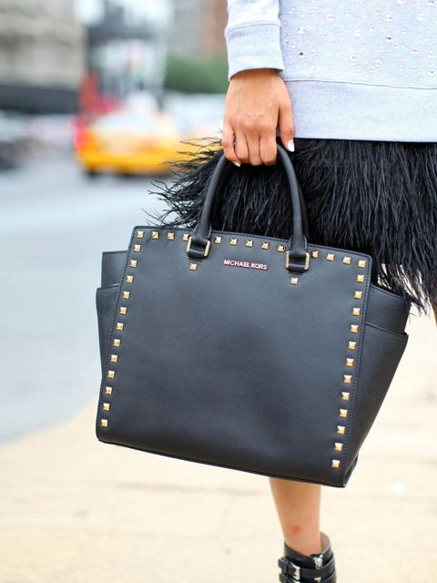 "<p>Kiloko Mima with Michael Kors bag.</p><p><em><a href=""http://www.elleuk.com/style/street-style/stockholm-fashion-week-street-style-2013"">Stockholm Fashion Week street style</a></em></p><p><em><a href=""http://www.elleuk.com/style/street-style/haute-cout"
