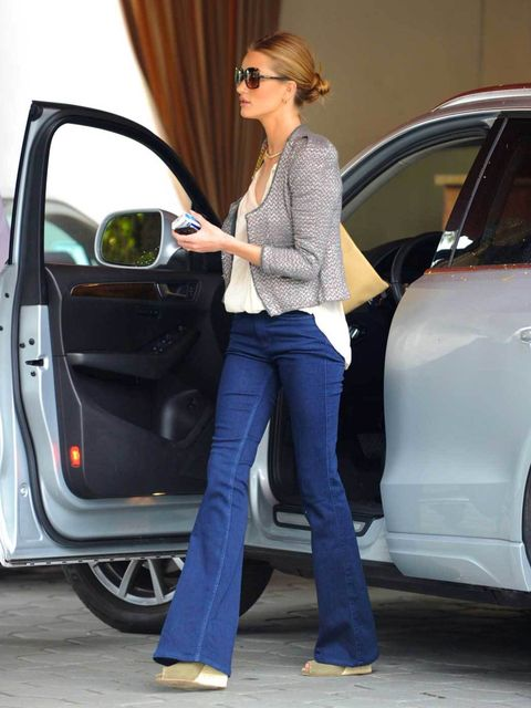 """<p><a href=""""http://www.elleuk.com/star-style/celebrity-style-files/rosie-huntington-whiteley"""">Rosie Huntington-Whiteley</a> teaming her cropped jacket with flared jeans, wedges and thr <a href=""""http://www.elleuk.com/catwalk/designer-a-z/gucci/spring-summe"""