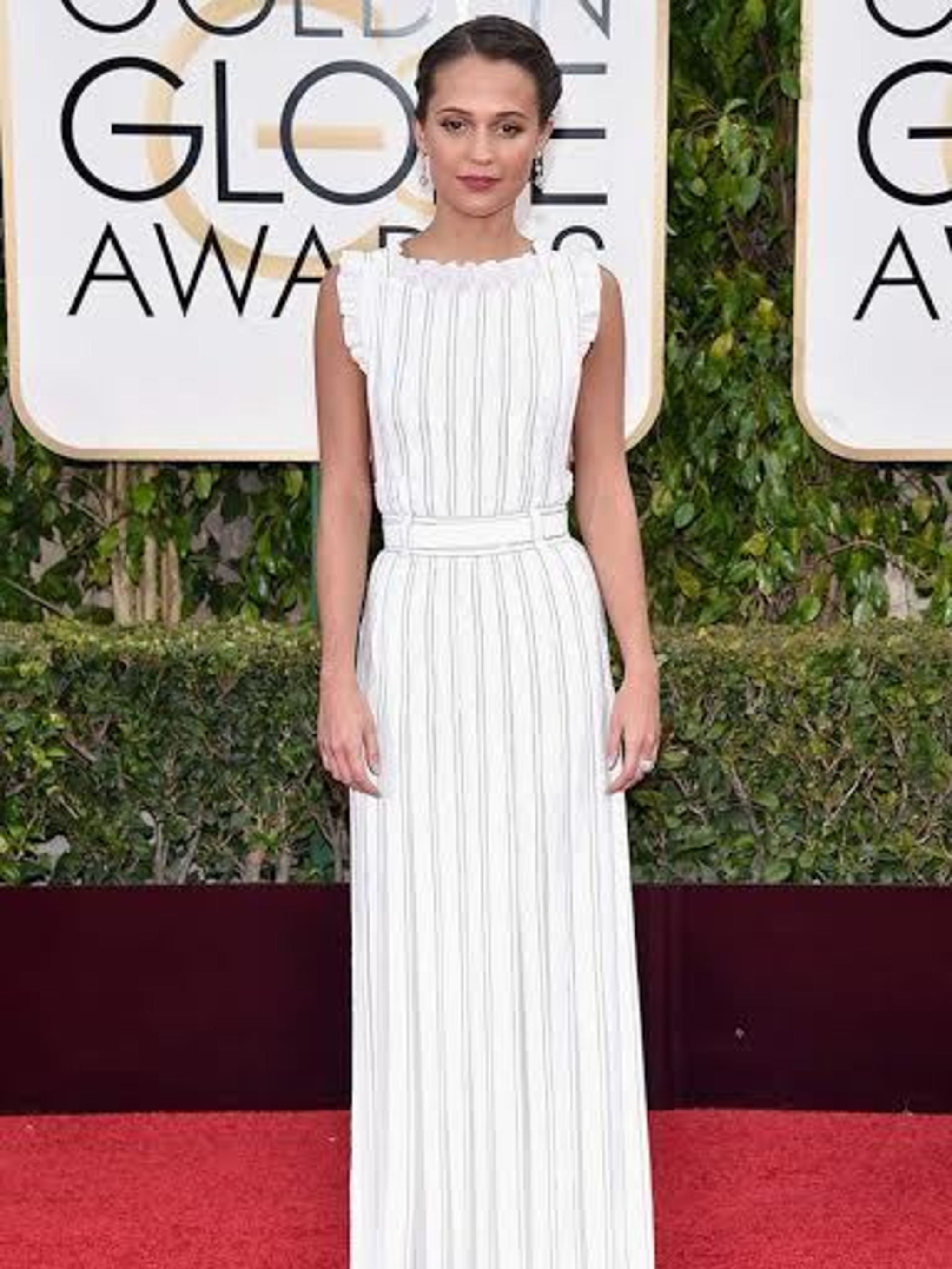 <p>Alicia Vikander in Louis Vuitton: I love how fresh and modern Alicia looks in this Vuitton gown. A brilliant example ofhow to black tie in a pretty and cool way. The pulled back hair and drop earrings add to thefeeling of relaxed glamour.</p>