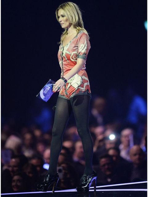 <p>Kate Moss wears David Bowie's rabbit costume to accept an award on his behalf at the BRIT Awards 2014.</p>