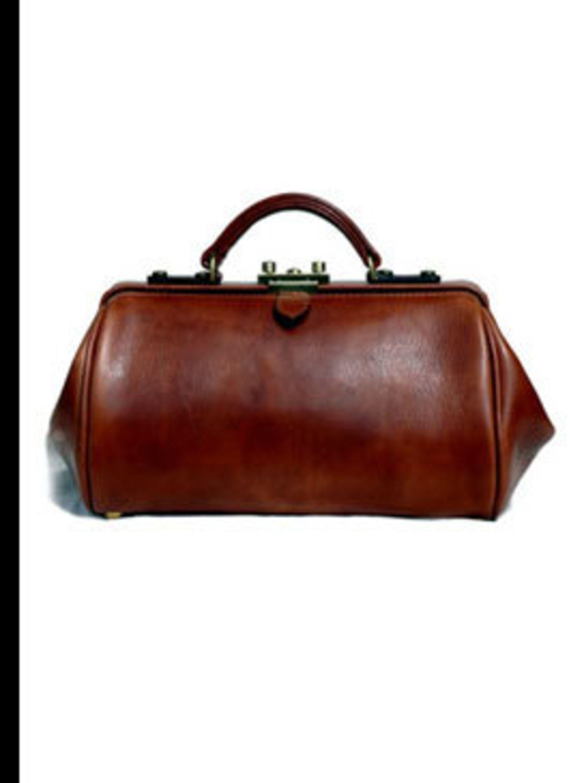 """<p>Gladstone bag, £320, by <a href=""""http://www.mackenzieleather.co.uk/index.htm"""">Alan Mackenzie</a></p>"""