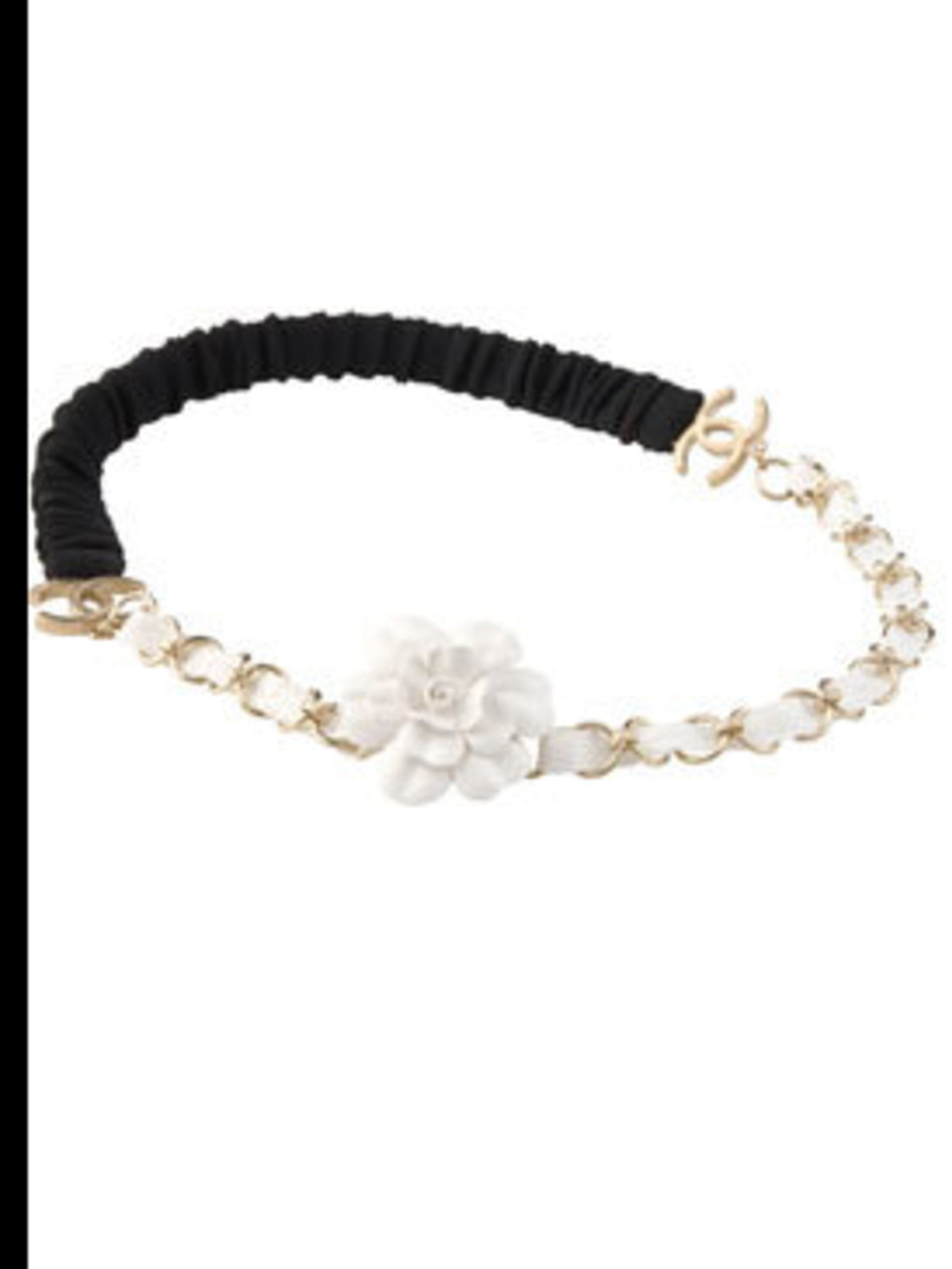<p>White camelia headband, £450, by Chanel (0207 493 5040 ) </p>