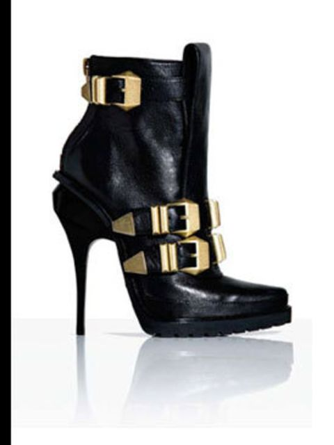 <p>Black ankle boots, £520, by Alexander Wang at Selfridges </p>