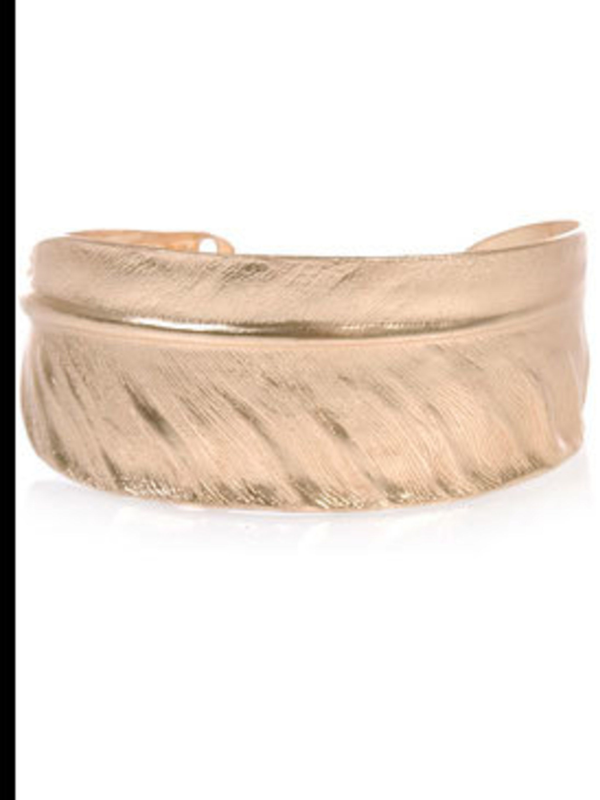 "<p>Gold-plated feather cuff, £52, by Sowat at <a href=""http://www.farfetch.com/shopping/women/search/item10016539.aspx"">Farfetch</a></p>"