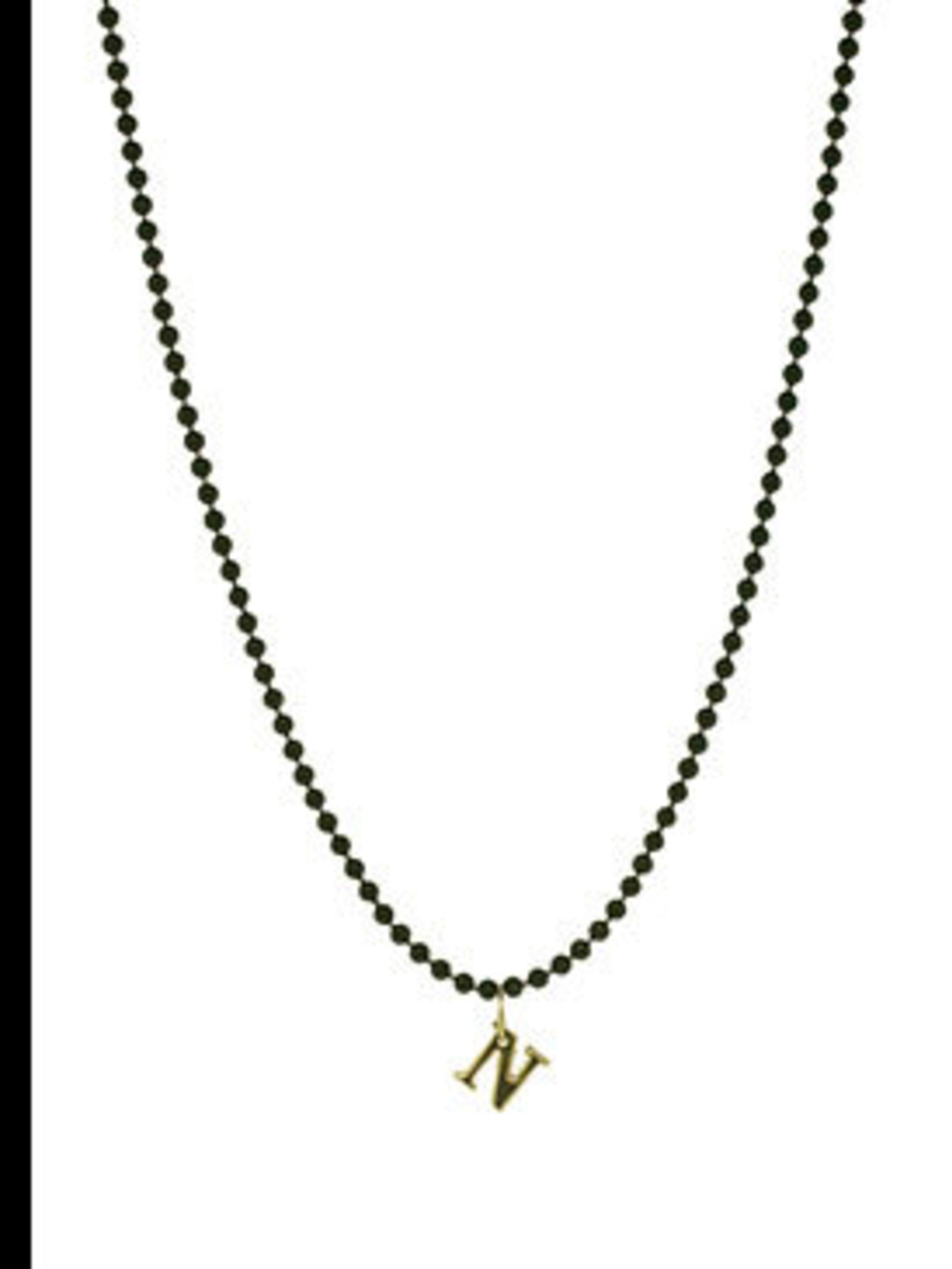 """<p>Letter necklace, £45, by Allumer at <a href=""""http://www.kabiri.co.uk/jewellery/necklaces/letter_charmn"""">Kabiri</a></p>"""
