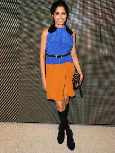 "<p><a href=""http://www.elleuk.com/content/search?SearchText=freida+pinto&SearchButto"">Freida Pinto</a> pairing a waist belt with a colour blocking dress at the Marni for H&M launch party</p>"