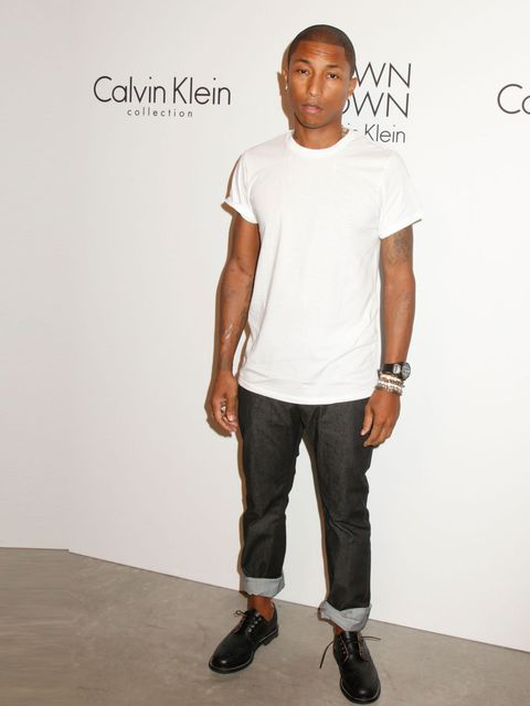 """<p><a href=""""http://www.elleuk.com/star-style/celebrity-style-files/pharrell-williams-man-of-the-week"""">Pharrell Williams</a> at the Calvin Klein show after party, New York Fashion Week, September 2013. </p><p><em><a href=""""http://www.elleuk.com/catwalk"""">Lat"""