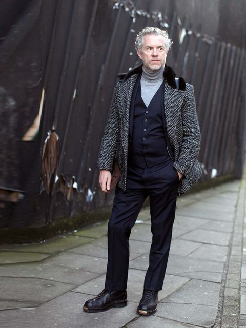 <p>Colin Chapman wears Baartman and Siegel coat, E Tautz suit, John Smedley roll-neck, Lou Dalton shoes.</p>