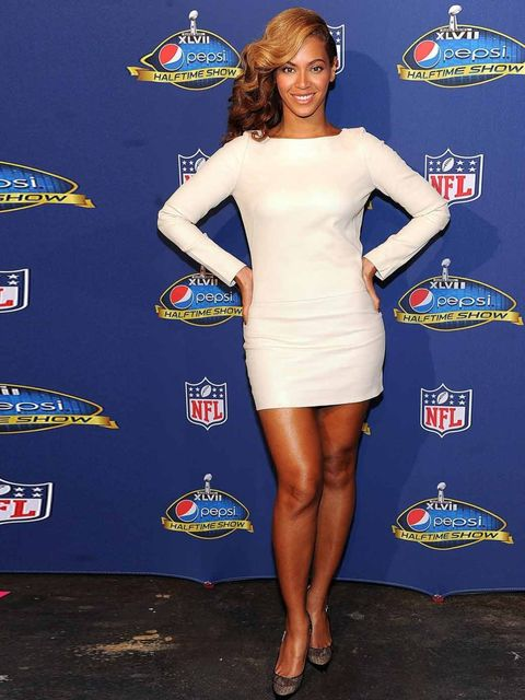 <p>Beyonce at the Super Bowl XLVII press conference in a Olcay Gulsen white dress, January 2013.</p>
