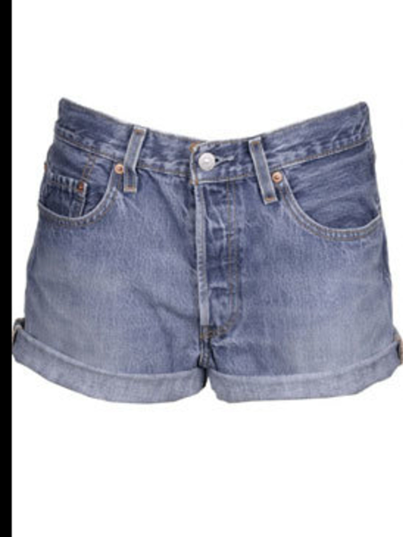 <p>Vintage denim shorts, £10, by Levi's at Rokit</p>