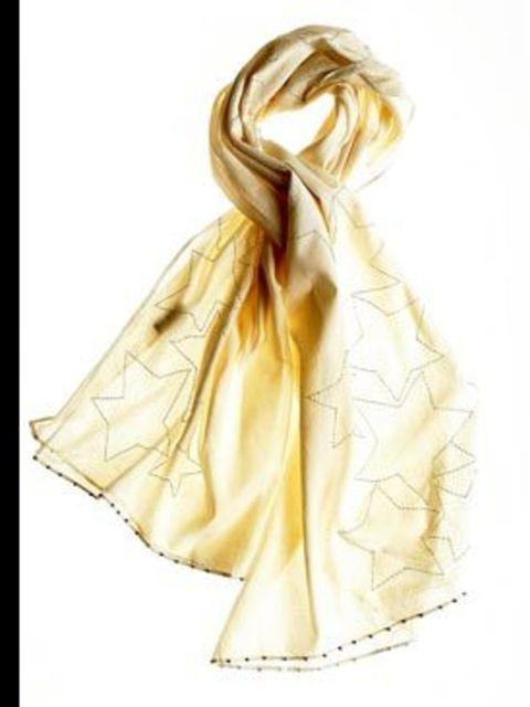 <p>Kara Pareo scarf, £61, by Antik Batik. For stockist details call 0845 094 4012</p>