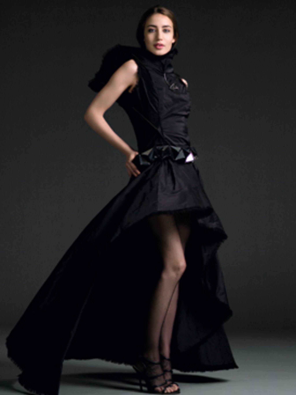 <p>Elizabeth Jagger wears long black dress by Nathalie Thomas.</p>
